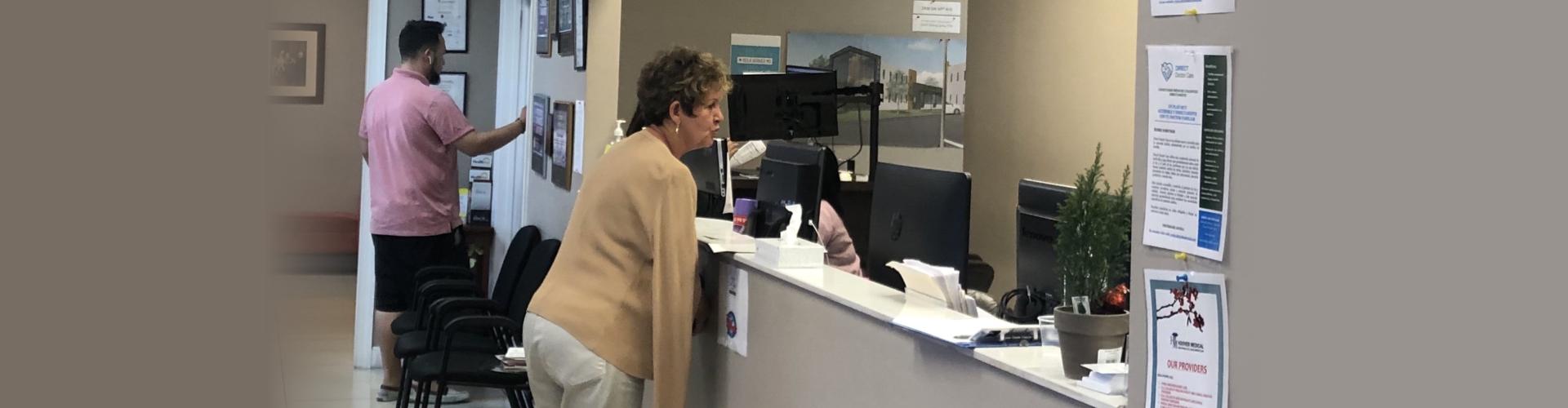 senior patient in hospital desk